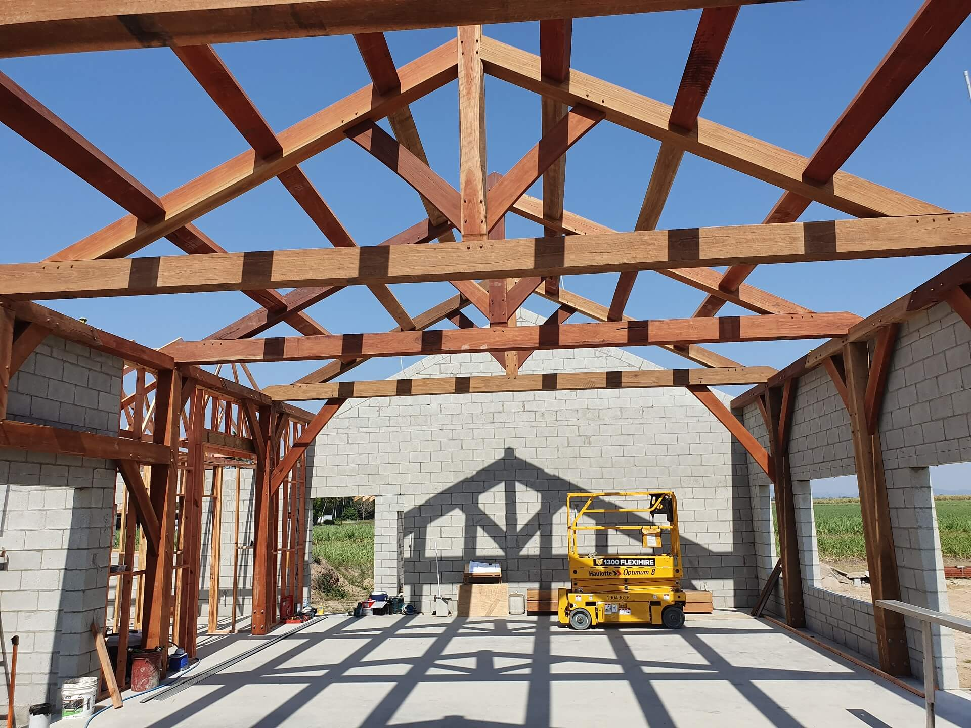 Looking up from beneath the large dimension timber trusses that will support the farm house roof