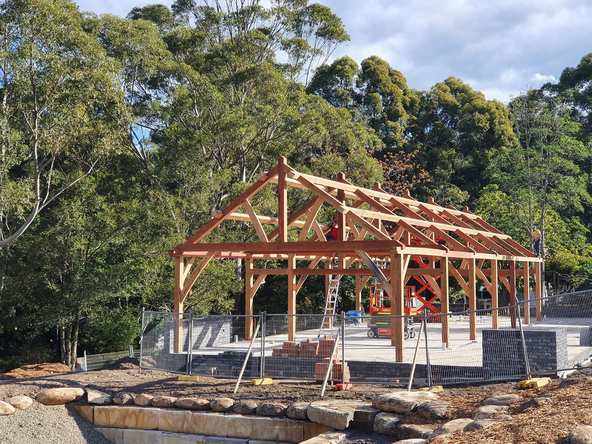 Traditionally built timber post and beam frame nearing completion