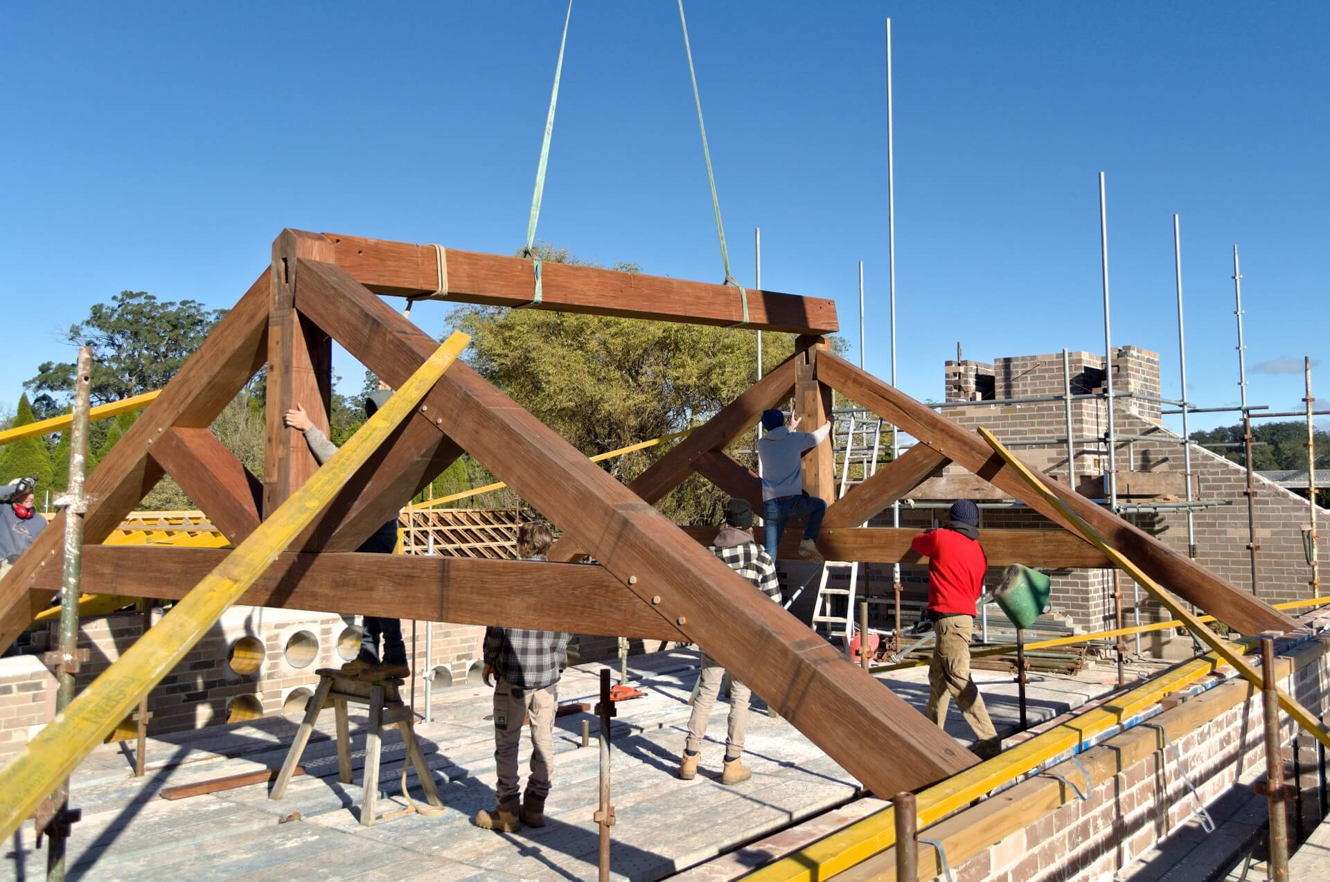 The entire TTF team working together to fit the huge ridge beam into place.
